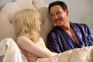 "Dakota Fanning as Beverly Aadland and Kevin Kline as Errol Flynn in ""The Last of Robin Hood."""