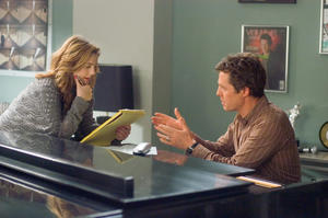 "Sophie Fisher (Drew Barrymore) and Alex Fletcher (Hugh Grant) attempt to write a hit single for Cora Corman in ""Music and Lyrics."""