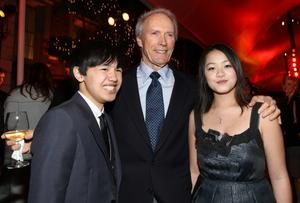 "Bee Vang, Director Clint Eastwood and Ahney Her at the after party of the California premiere of ""Gran Torino."""