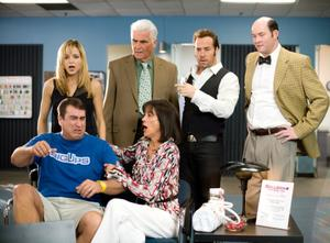 "Jordana Spiro as Ivy Selleck, James Brolin as Ben Selleck, Jeremy Piven as Don Ready, David Koechner as Brent Gage, Rob Riggle as Peter Selleck and Wendie Malick as Tammy in ""The Goods: Live Hard. Sell Hard."""
