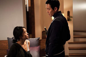 "Jeon Do-yeon as Housemaid Eun-i and Lee Jeong-jae as Master Hoon in ""The Housemaid"""