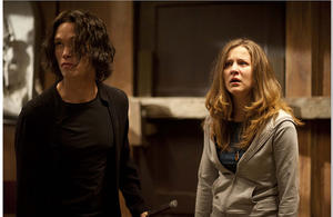 "Jordan Matthews and Hallee Hirsch in ""Fading of the Cries."""