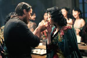 "Christian Bale as John Miller and Ni Ni as Yu Mo in ""The Flowers of War."""