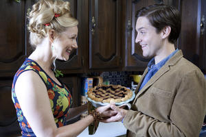 "Laura Linney as Lila and Tobey Maguire as Jeff Lang in ""The Details."""