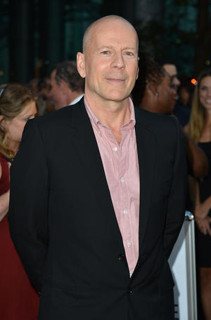 """Bruce Willis at the opening night gala premiere of """"Looper"""" during the 2012 Toronto International Film Festival."""