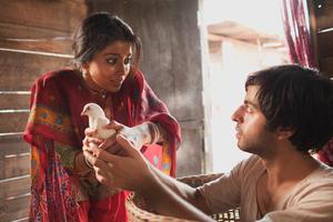 "Shriya Saran and Satya Bhabha in ""Midnight's Children."""