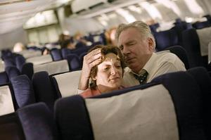 "Becky London and Tom O'rourke as Jean and Donald Peterson comfort one another in ""United 93."""