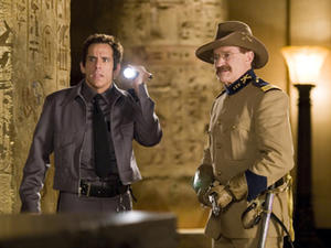 "Larry Daley (Ben stiller), a night guard, searches the Egyptian tomb with Roosevelt (Robin Williams) in ""Night at the Museum."""