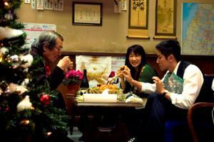 """Tsutomu Yamazaki as Sasaki, Kimiko Yo as Yuriko Kamimura and Masahiro Motoki as Daigo Kobayashi in """"Departures."""""""