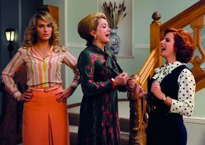 "Judith Godreche as Joelle, Catherine Deneuve as Suzanne Pujol and Karin Viard as Nadege in ""Potiche."""