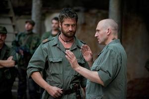 """Gerard Butler as Tullus Aufidius and Ralph Fiennes as Caius Martius in """"Coriolanus."""""""