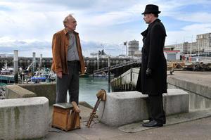 "Andre Wilms as Marcel Marx and Jean-Pierre Darroussin as Monet in ""Le Havre."""