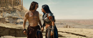 "Taylor Kitsch as John Carter and Lynn Collins as Dejah Thoris in ""John Carter."""