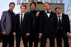 12 Great Movie Entourages