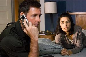 "Ed Burns and Shannyn Sossamon in ""One Missed Call."""