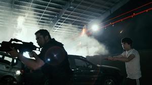 "Gerard Butler as Kable and Logan Lerman as Simon in ""Gamer."""