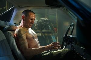 "Chester Bennington as Evan in ""Saw VII."""