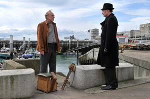 "Andre Wilms as Marcel Marx and Jean-Pierre Darroussin as Monet in ""Le Havre."""