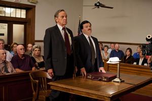 "Brady Coleman as Scrappy Holmes and Jack Black as Bernie Tiede in ""Bernie."""