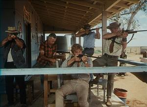 "Donald Pleasence as Doc Tydon and Gary Bond as John Grant in ""Wake in Fright."""