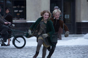 "Sophie Nelisse as Liesel and Nico Liersch as Rudy in ""The Book Thief."""