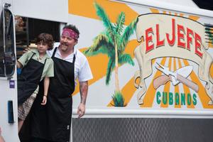 "Emjay Anthony as Percy Casper and Jon Favreau as Carl Casper in ""Chef."""