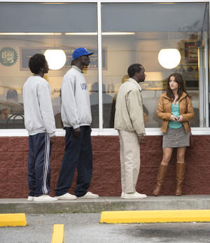 """Emmanuel Jal as Paul, Ger Duany as Jeremiah, Arnold Oceng as Mamere and Reese Witherspoon as Carrie in """"The Good Lie."""""""