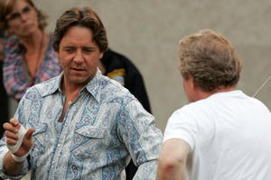 """Actor Russell Crowe and director Ridley Scott on set during the filming of """"American Gangster."""""""