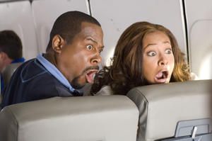"""Martin Lawrence and Raven Symone in """"College Road Trip."""""""