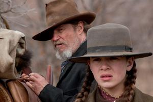 "Jeff Bridges as Rooster Cogburn and Hailee Steinfeld as Mattie Ross in ""True Grit."""