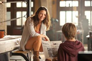 "Evangeline Lilly as Bailey Tallet and Dakota Goyo as Max in ""Real Steel."""