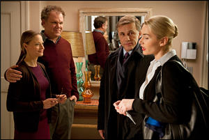 "Jodie Foster as Penelope Longstreet, John C. Reilly as Michael Longstreet, Christoph Waltz as Alan Cowan and Kate Winslet as Nancy Cowan in ""Carnage."""
