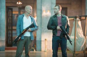 "Bruce Willis as John McClane and Jai Courtney as John Genarro in ""A Good Day to Die Hard."""