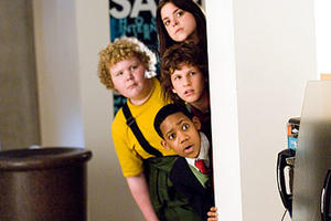 "Gina Mantegna, Brett Kelly, Dyllan Christopher, and Tyler James Williams in ""Unaccompanied Minors."""