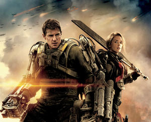 "Tom Cruise as Major William Cage and Emily Blunt as Rita Vrataski in ""Edge of Tomorrow."""