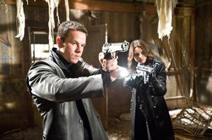 """Mark Wahlberg as Max Payne and Mila Kunis as Mona Sax in """"Max Payne."""""""