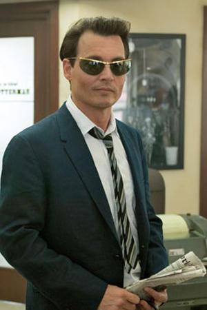 """Johnny Depp as Paul Kemp in """"The Rum Diary."""""""