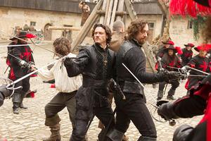 "Logan Lerman as D'Artagnan, Luke Evans as Athos, Ray Stevenson as Porthos and Matthew MacFadyen as Aramis in ""The Three Musketeers."""