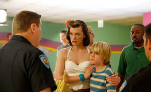 "Milla Jovovich and Spencer List in ""Bringing Up Bobby."""