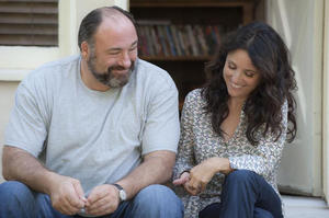 "James Gandolfini as Albert and Julia Louis-Dreyfus as Eva in ""Enough Said."""