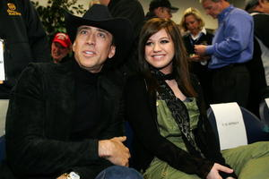 """""""Next"""" star Nicolas Cage and singer Kelly Clarkson at the NASCAR Nextel Cup Series Daytona 500."""