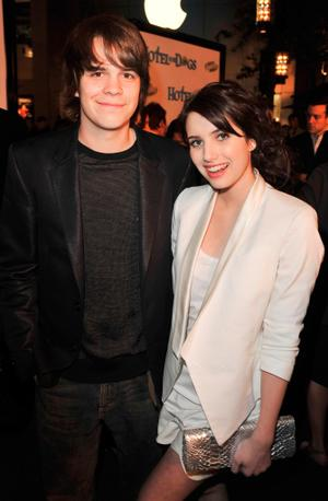 "Johnny Simmons and Emma Roberts at the California premiere of ""Hotel for Dogs."""