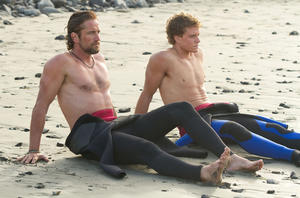 "Gerard Butler as Frosty Hesson and Jonny Weston as Jay Moriarity in ""Chasing Mavericks."""
