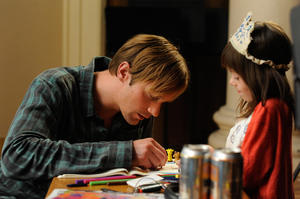 """Alexander Skarsgard as Lincoln and Onata Aprile as Maisie in """"What Maisie Knew."""""""