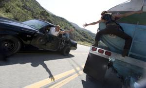 """Vin Diesel as Dom Toretto and Michelle Rodriguez as Letty in """"Fast & Furious."""""""