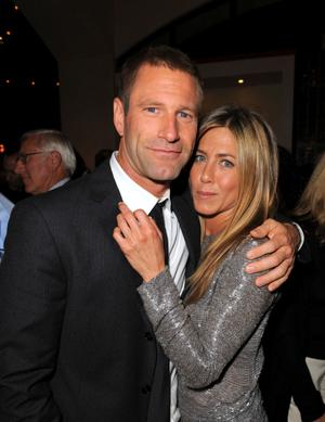 "Aaron Eckhart and Jennifer Aniston at the after party of the California premiere of ""Love Happens."""