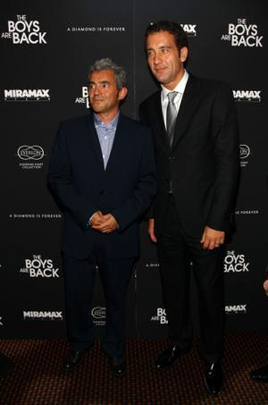 """Daniel Battsek and Clive Owen at the New York premiere of """"The Boys Are Back."""""""