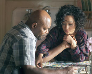 "Samuel L.Jackson as Foley and Ruth Negga as Iris in ""The Samaritan."""