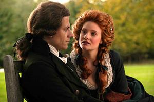 "William Wilberforce (Ioan Gruffudd) speaks with Barbara Spooner (Romola Garai) about abolition in ""Amazing Grace."""