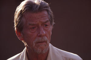 "John Hurt as Christopher, a Catholic priest, in ""Beyond the Gates."""